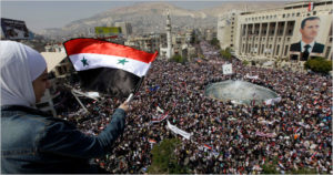 Manifestación de apoyo a Al-Assad convocada por el régimen en Damasco.
